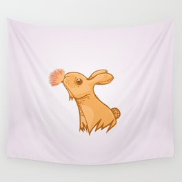 Bunny smelling a flower Wall Tapestry