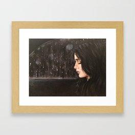 sad women in rain Framed Art Print