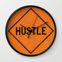 """hustle Wall Clocks featuring HUSTLE by """"dfrnt"""""""