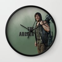 archer Wall Clocks featuring The Archer by Valerie Canizales