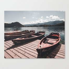 wooden boat at lake bled in the summer Canvas Print