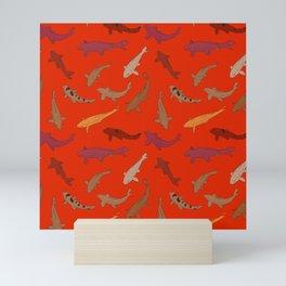 Koi carp. Brown orange yellow black outline on red background Mini Art Print