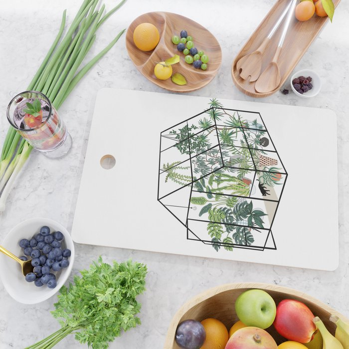 greenhouse with plants Cutting Board
