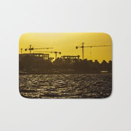 Cranes of a construction workshop at Izmir (Turkey) during sunset Bath Mat