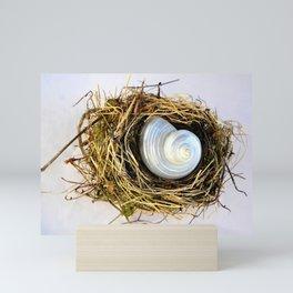 BIRD NEST AND WHITE SEASHELL Mini Art Print
