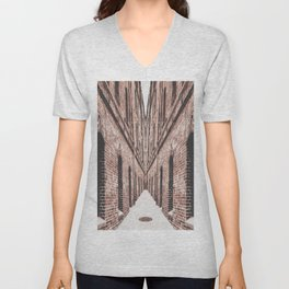 walkway in the middle of the brown brick buildings Unisex V-Neck