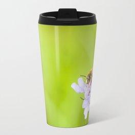A bee on a flower Travel Mug