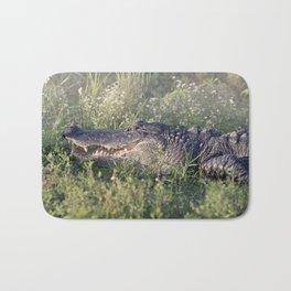 Alligator sunning in grass Bath Mat