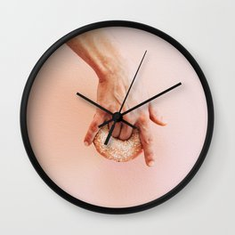 hand holds donut Wall Clock