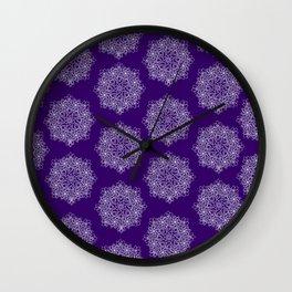 Christmas star on purple Wall Clock