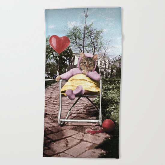 A pretty, little kitty with a heart-shaped balloon Beach Towel
