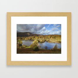 Sunlight over Tarn Hows with Wetherlam and Langdale Pikes beyond. Lake District, UK. Framed Art Print