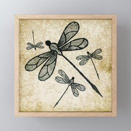 Dragonflies on tan texture Framed Mini Art Print