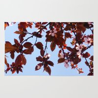 cherry blossom Area & Throw Rugs featuring Cherry Blossom by madbiffymorghulis