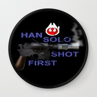 han solo Wall Clocks featuring HAN SOLO SHOT FIRST by Dan Solo Galleries