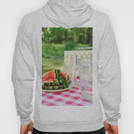 Watermelon and water carafe on garden table Hoody