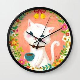 A cat who drinks tea Wall Clock