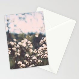 Faded white flowers on the side of a mountain Stationery Cards