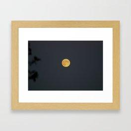 Amazing Full Orange Moon Rising over Trees Framed Art Print