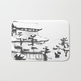 Traditional Japanese house in snow Bath Mat