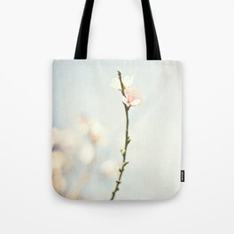 jutting bloom Tote Bag