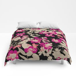 pink flower with silhouette leaves on black Comforters