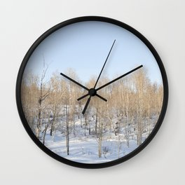 Snowfall and treetops Wall Clock