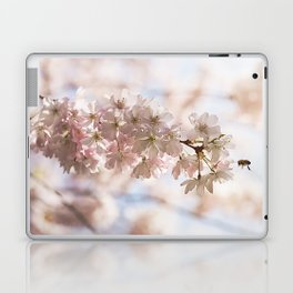Bee and cherry branches against the blue sky Laptop & iPad Skin