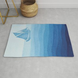 Lonely sailing ship Rug