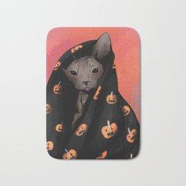 Brown Sphynx Cat Snuggled Up In a Halloween Pumpkin Blanket Bath Mat