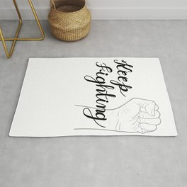 Keep fighting, hand written calligraphy with raised hands up. Rug