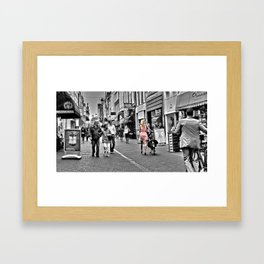 Woman in the city Framed Art Print