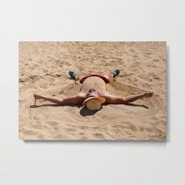 Portrait of a man baking in the sun on the sandy beach Metal Print