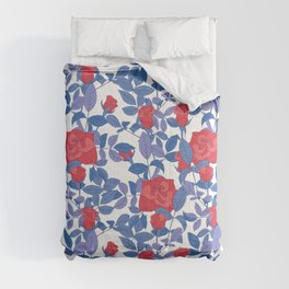 Red roses and blue leaves. Comforters