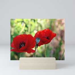 poppies in the summer Mini Art Print