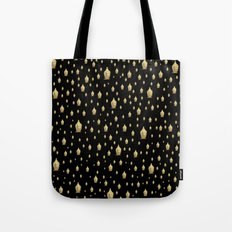 many small golden buddha heads designed artistically into a festive pattern Tote Bag