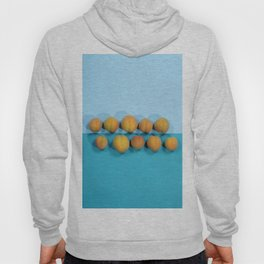 Ripe apricots on a blue background Hoody