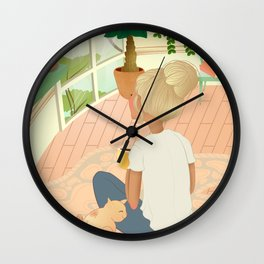 girl with cat relaxing at home looking out the window Wall Clock