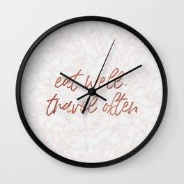 eat well, travel often Wall Clock