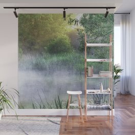 Landscape photograph of a foggy morning on a pond with light starting to break through. Wall Mural