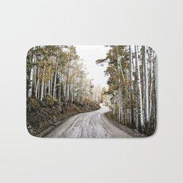 A Winding Autumn Road Bath Mat