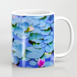 Water lilies in a pond Coffee Mug