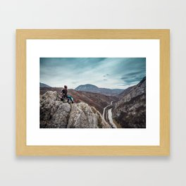 Girl sitting on the bench on the edge of the canyon with amazing view in front of her Framed Art Print