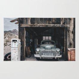 Old vintage car truck abandoned in the desert Rug