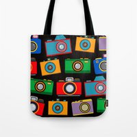 cameras Tote Bags featuring colourful cameras by vitamin
