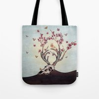 animal skull Tote Bags featuring Animal Skull and Butterflies by Paula Belle Flores