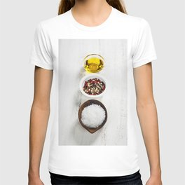 Salt, pepper and olive oil on a wooden board T-shirt