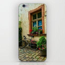 Scene on a German cobblestone alley iPhone Skin