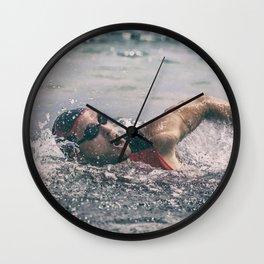 Swimmer in ocean Wall Clock