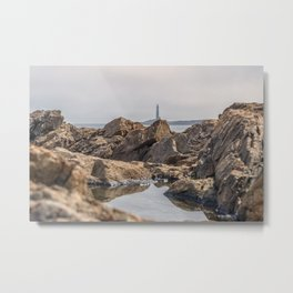 Puddle on the rocks with the north tower Metal Print
